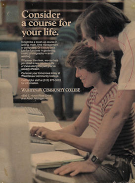 Laurence helping a computer student in a Washtenaw Community College pulblicity photo